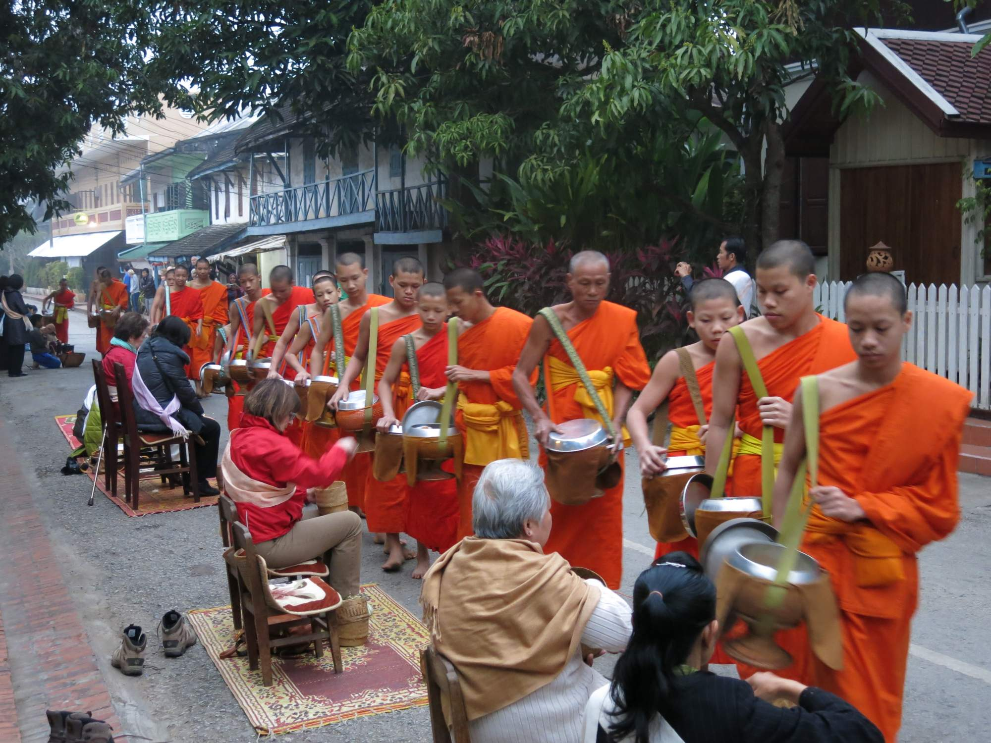 monks collecting alms luang prabang