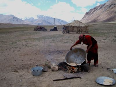 Tajik woman making bread
