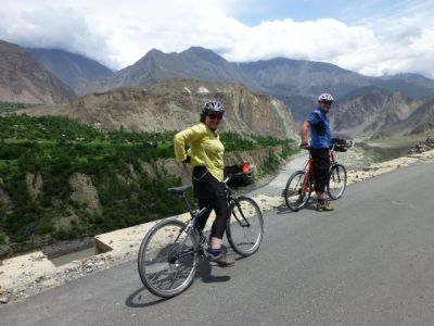 Donald and Mary Cycling on the Karakoram Highway to Kyrgyzstan tour with redspokes