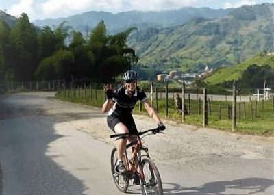 Angela Riddell Cycling on the  tour with redspokes