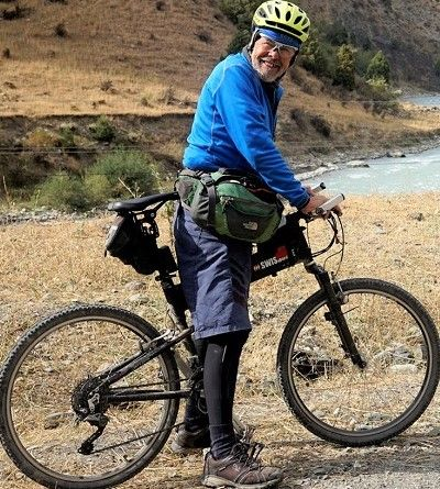 Bob Harrison Cycling on the Karakoram Highway to Kyrgyzstan tour with redspokes