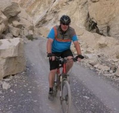 Colm Faherty Cycling on the Karakoram Highway to Kyrgyzstan tour with redspokes