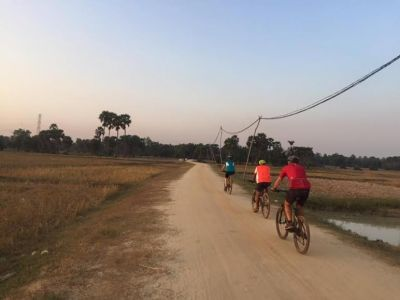 Robert Tuck Cycling on the Cambodia  tour with redspokes