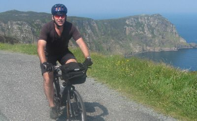 Kevin Sheedy Cycling on the Discover Ireland  tour with redspokes