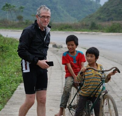 Chris Darke Cycling on the Vietnam N.E tour with redspokes