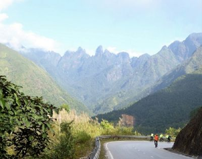 David Mercer Cycling on the Vietnam to Laos tour with redspokes