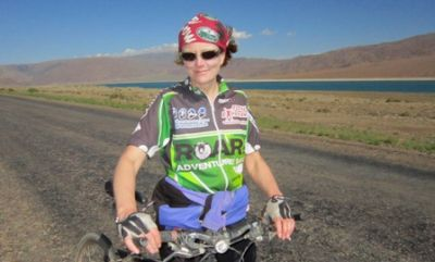 Corina Naughton Cycling on the Karakoram Highway to Kyrgyzstan tour with redspokes
