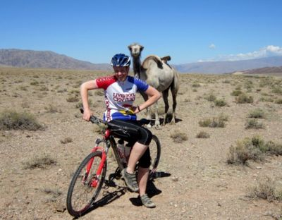 Hannah MacDonald Cycling on the Karakoram Highway to Kyrgyzstan tour with redspokes