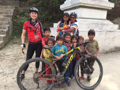 Hayley Mann Cycling on the Nepal  tour with redspokes