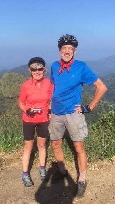 Pete & Judy Burdett Cycling on the  tour with redspokes