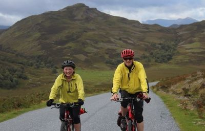 Shirley and Trevor Acreman Cycling on the  tour with redspokes