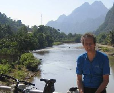 Nigel Fielden Cycling on the Vietnam to Laos tour with redspokes