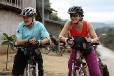 Michele McCoy and Malcolm Dean Cycling on the Thailand & Laos tour with redspokes