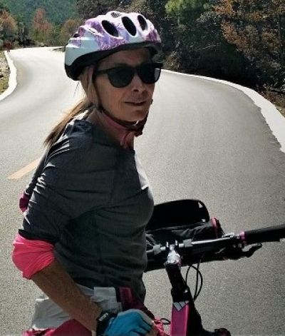 Marie Clune Cycling on the  tour with redspokes