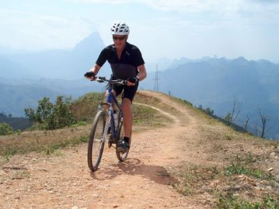Alastair Locke Cycling on the Thailand & Laos tour with redspokes