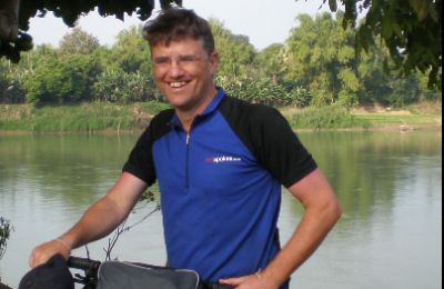 Paul Massie Cycling on the Laos - South to North tour with redspokes