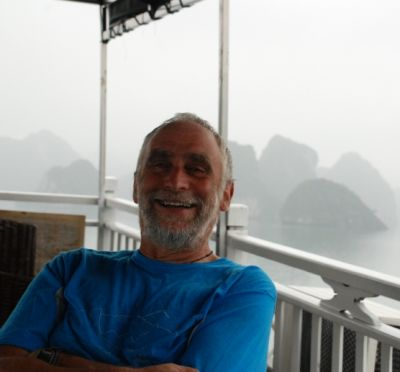Peter Dilks Cycling on the Vietnam N.E tour with redspokes