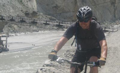 Stephen Phillips Cycling on the Karakoram Highway to Kyrgyzstan tour with redspokes