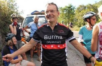 Roger Troughton Cycling on the Burma - Classic tour with redspokes