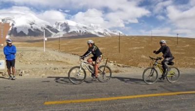 Sandra Groenewold Cycling on the Karakoram Highway to Kyrgyzstan tour with redspokes