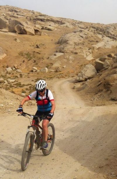 Sarah Howes Cycling on the Uzbekistan tour with redspokes