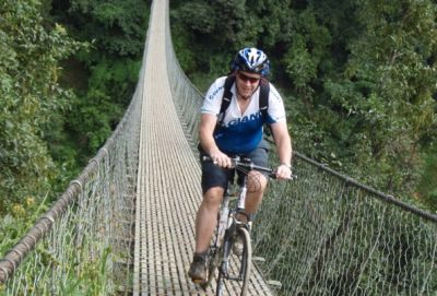 Trevor Andrews Cycling on the Nepal tour with redspokes