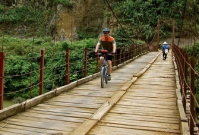 Chris Morfas Cycling on the Vietnam to Laos tour with redspokes