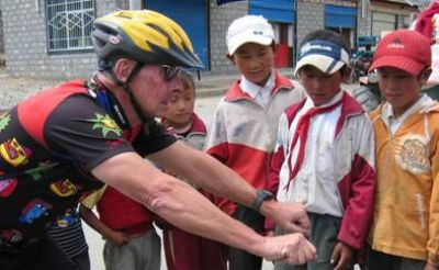 John Goveia Cycling on the Lhasa to Kathmandu tour with redspokes