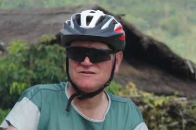 Phil Nelson Cycling on the Vietnam N.W   tour with redspokes