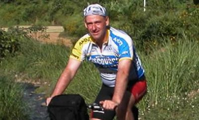 Ian Smith Cycling on the  tour with redspokes