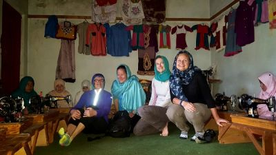 Heather Wickham Cycling on the Karakoram Highway to Kyrgyzstan tour with redspokes