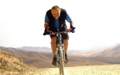 Robert Forster Cycling on the Karakoram Highway to Kyrgyzstan tour with redspokes