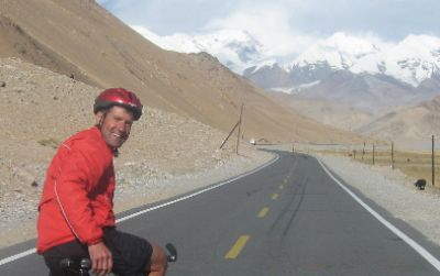 Simon Clayton Cycling on the  tour with redspokes