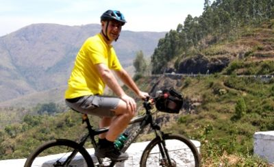 Ian Smith Cycling on the India - Kerala tour with redspokes