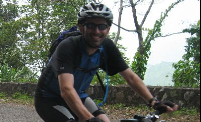 Graham Searle Cycling on the Laos - South to North tour with redspokes