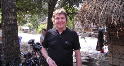 Mark Pearson Cycling on the Laos - South to North tour with redspokes