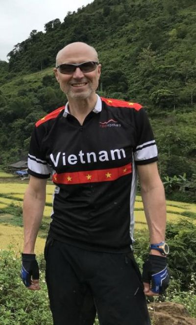 Paul Emms Cycling on the Vietnam N.E tour with redspokes