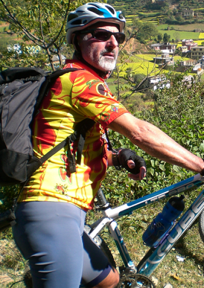 Piero Tassinari Cycling on the  tour with redspokes