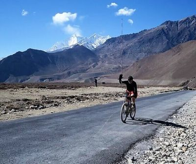 Richard Matheson Cycling on the Nepal  tour with redspokes