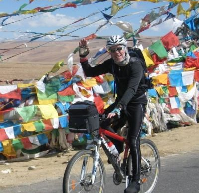 Chris Darke  Cycling on the Lhasa to Kathmandu tour with redspokes