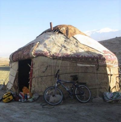 Wendy Holland Cycling on the Karakoram Highway to Kyrgyzstan tour with redspokes